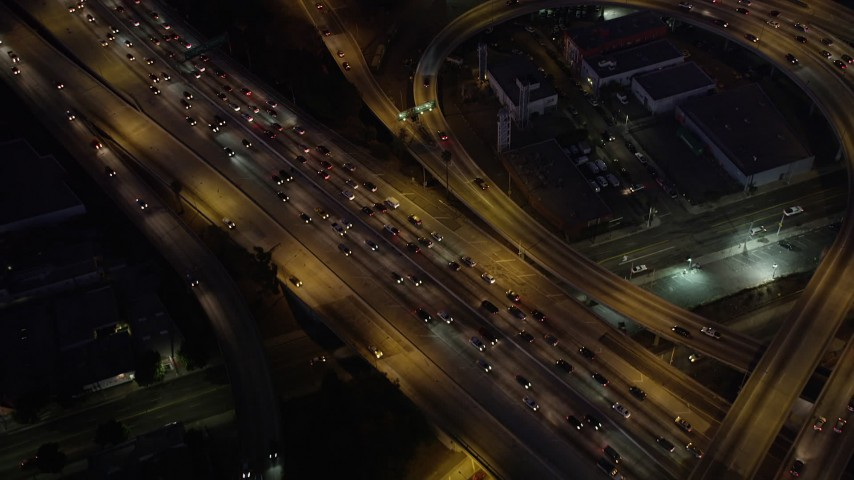 5K stock footage aerial video of bird's eye view of the I-110 / 10 interchange in Downtown Los Angeles, California at night Aerial Stock Footage | AX69_097