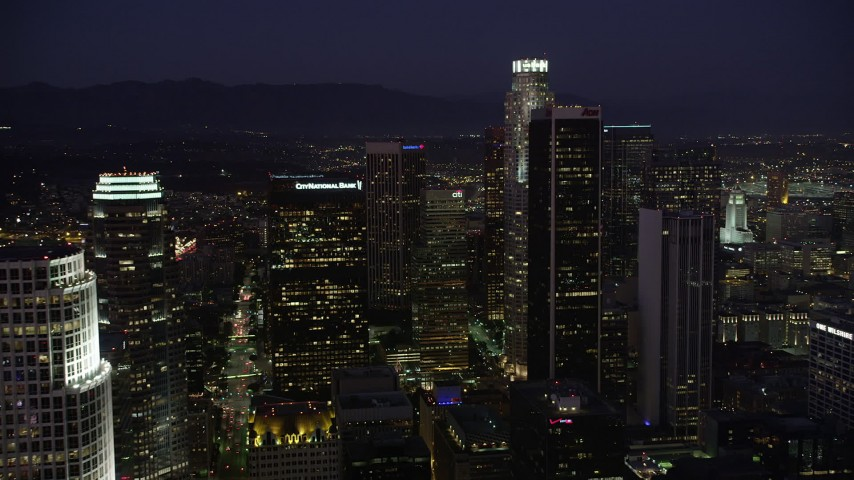 5K stock footage aerial video approach the tall skyscrapers of Downtown Los Angeles, California at night Aerial Stock Footage | AX69_099