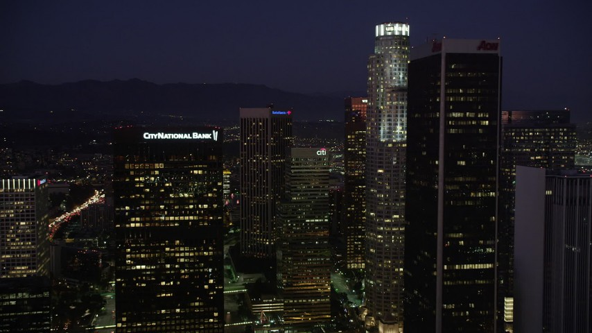 5K stock footage aerial video fly between skyscrapers in Downtown Los Angeles, California at night Aerial Stock Footage | AX69_100