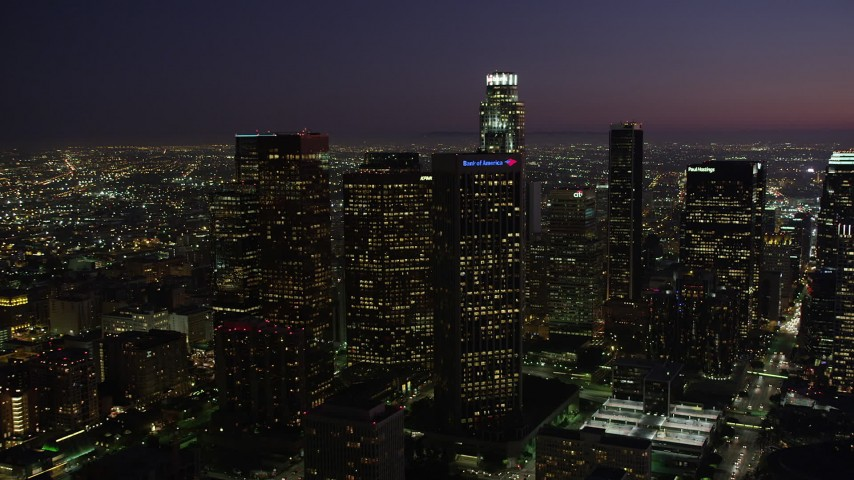 5K stock footage aerial video of skyscrapers in Downtown Los Angeles, California at night Aerial Stock Footage | AX69_103