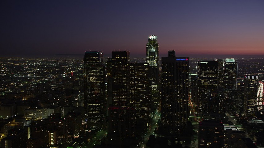 5K stock footage aerial video orbit tall high-rises in Downtown Los Angeles, California at night Aerial Stock Footage | AX69_104