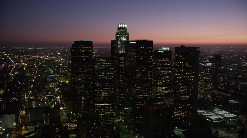 Orbit skyscrapers in Downtown Los Angeles, California at nighttime Aerial Stock Footage | AX69_105