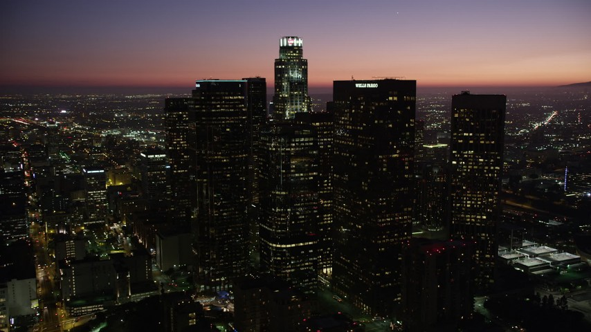 5K stock footage aerial video orbit skyscrapers in Downtown Los Angeles, California at nighttime Aerial Stock Footage | AX69_105