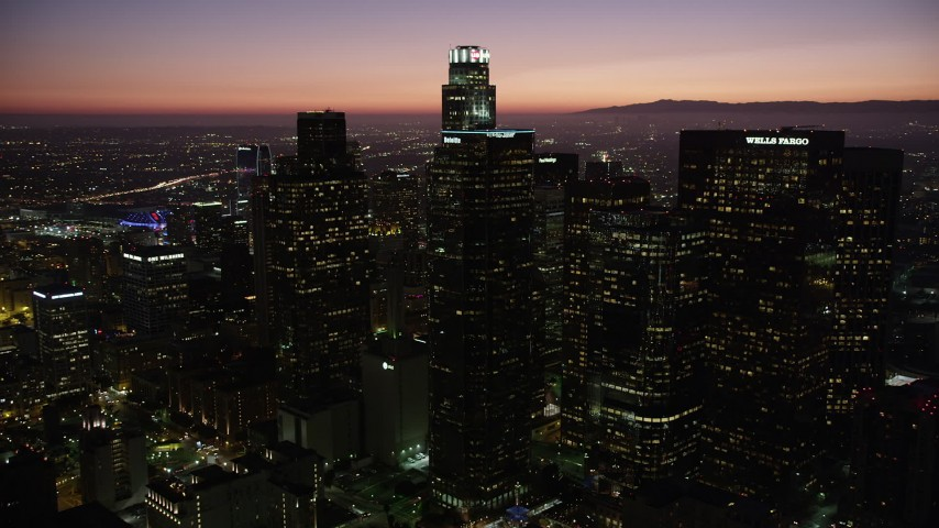 Orbit around Downtown Los Angeles skyscrapers at night, California Aerial Stock Footage | AX69_106