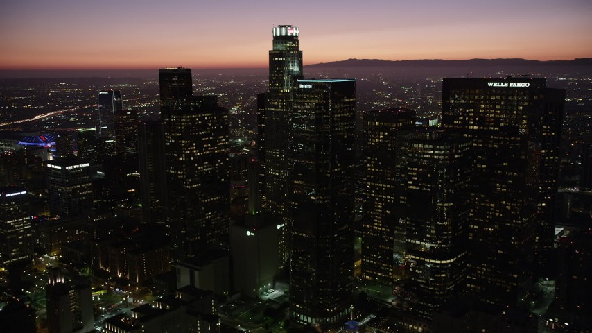 5K stock footage aerial video orbit around Downtown Los Angeles skyscrapers at night, California Aerial Stock Footage | AX69_106