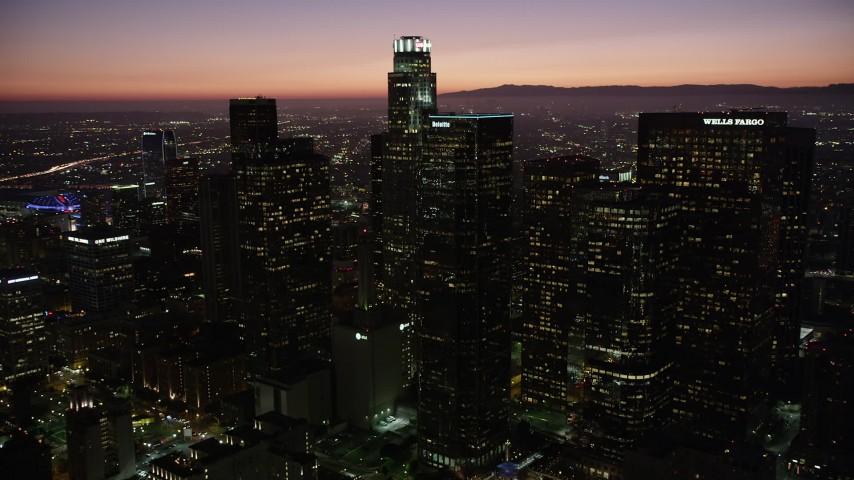 5K stock footage aerial video orbit around Downtown Los Angeles skyscrapers at night, California Aerial Stock Footage | AX69_106