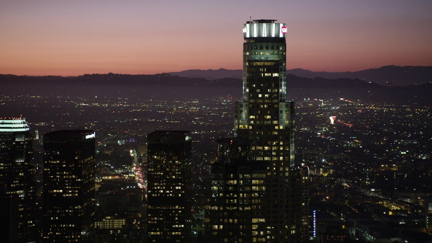 US Bank Tower in Downtown Los Angeles, California at night Aerial Stock Footage | AX69_108