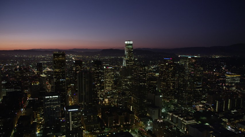 Passing Downtown Los Angeles' tall towers at nighttime, California Aerial Stock Footage | AX69_109