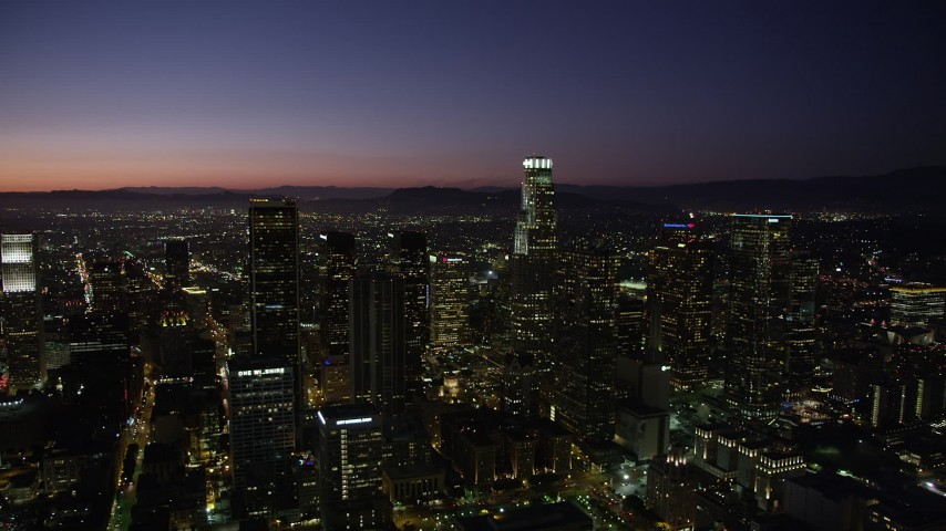 5K stock footage aerial video of passing Downtown Los Angeles' tall towers at nighttime, California Aerial Stock Footage | AX69_109