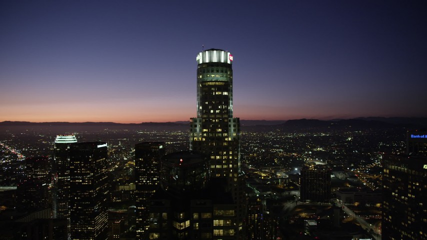 Orbit of US Bank Tower in Downtown Los Angeles at night, California Aerial Stock Footage | AX69_112