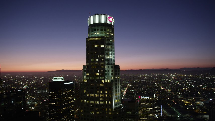 An orbit of US Bank Tower in Downtown Los Angeles at nighttime, California Aerial Stock Footage | AX69_113