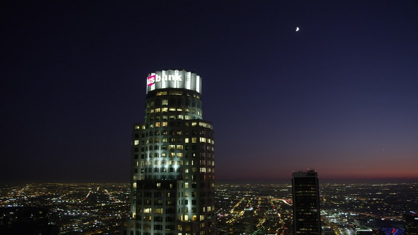 Orbit around US Bank Tower in Downtown Los Angeles, California at night Aerial Stock Footage | AX69_114