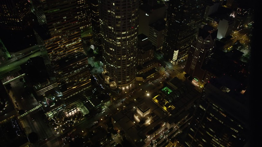 5K stock footage aerial video of Los Angeles Public Library and 5th Street in Downtown Los Angeles at night, California Aerial Stock Footage | AX69_115