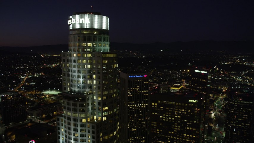 Orbiting the top of US Bank Tower in Downtown Los Angeles at night, California Aerial Stock Footage | AX69_116