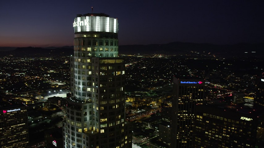 5K stock footage aerial video of orbiting the top of US Bank Tower in Downtown Los Angeles at night, California Aerial Stock Footage | AX69_116