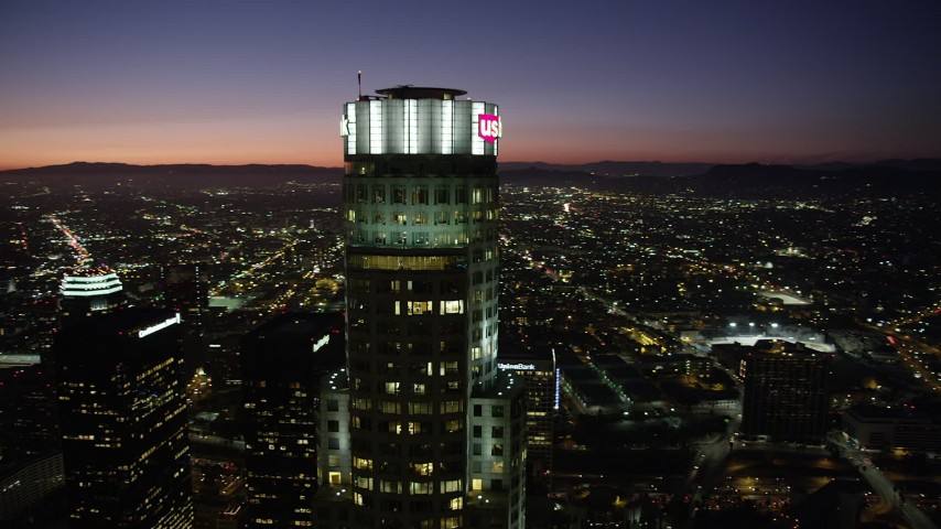 Orbiting top of US Bank Tower in Downtown Los Angeles at nighttime, California Aerial Stock Footage | AX69_117