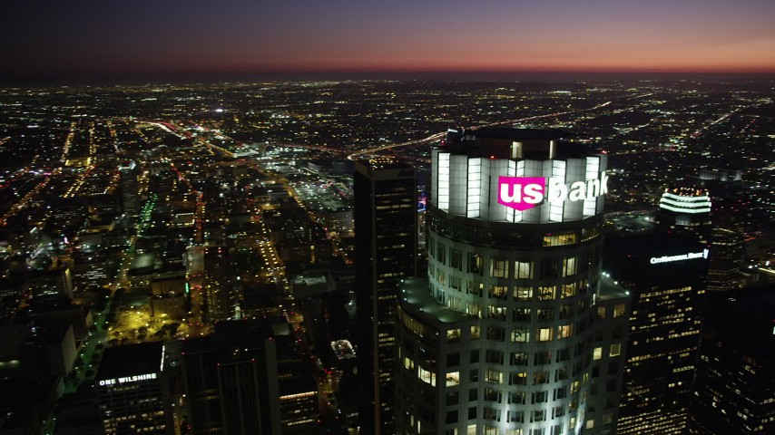 Orbit of the top of US Bank Tower in Downtown Los Angeles at night, California Aerial Stock Footage | AX69_118