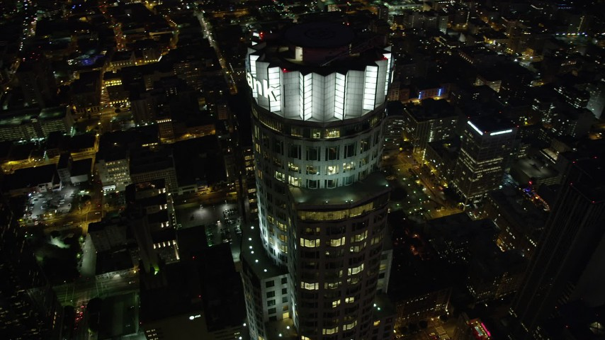 Bird's eye view of US Bank Tower in Downtown Los Angeles at night, California Aerial Stock Footage | AX69_119