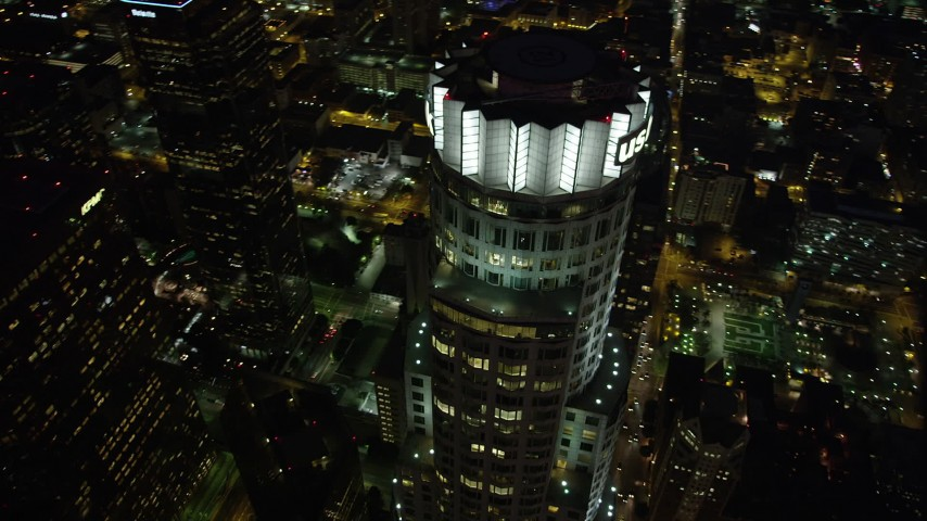 5K stock footage aerial video bird's eye view of US Bank Tower in Downtown Los Angeles at night, California Aerial Stock Footage | AX69_119