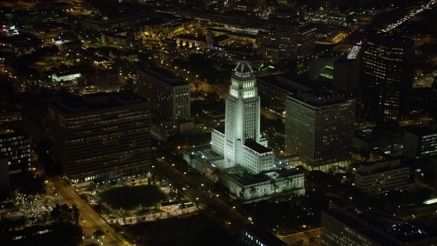 5K stock footage aerial video of Los Angeles City Hall and courthouse in Downtown Los Angeles, California at nighttime Aerial Stock Footage | AX69_120