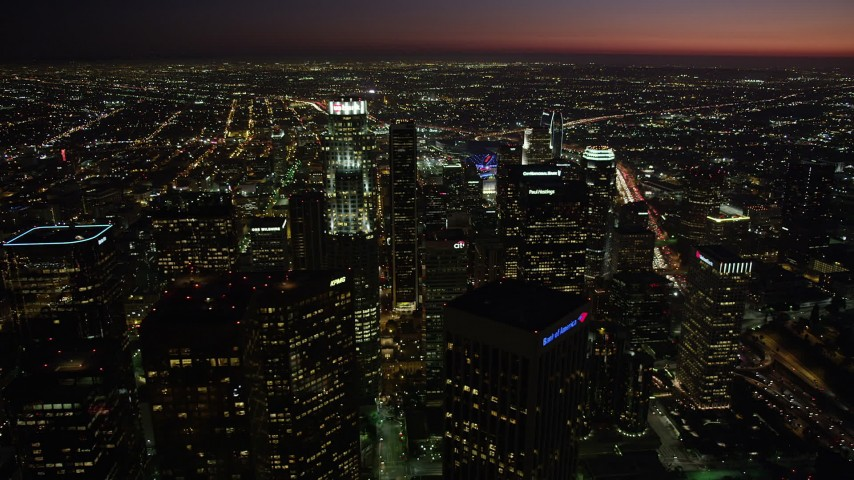 Pan and approach US Bank Tower in Downtown Los Angeles, California at night Aerial Stock Footage | AX69_121