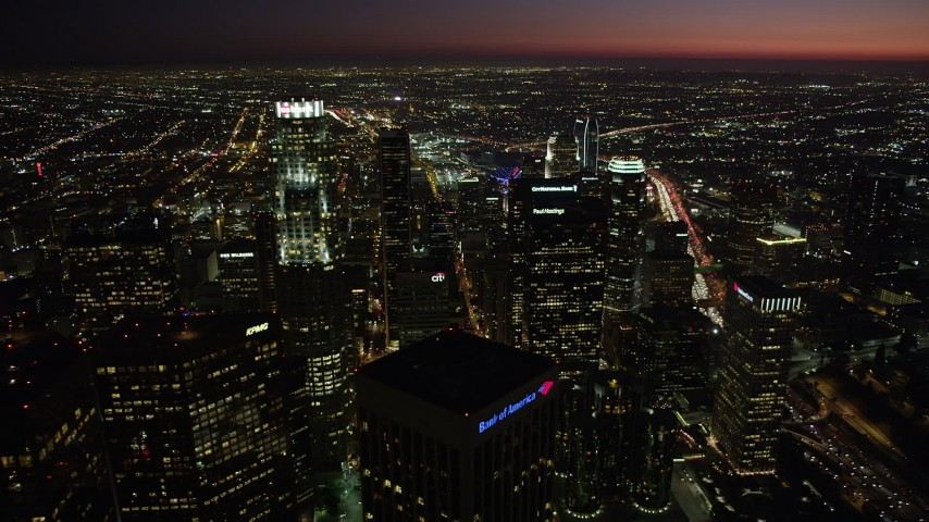 5K stock footage aerial video pan and approach US Bank Tower in Downtown Los Angeles, California at night Aerial Stock Footage | AX69_121