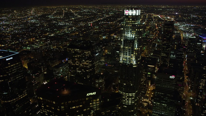 Approach and orbit US Bank Tower in Downtown Los Angeles, California at nighttime Aerial Stock Footage | AX69_122