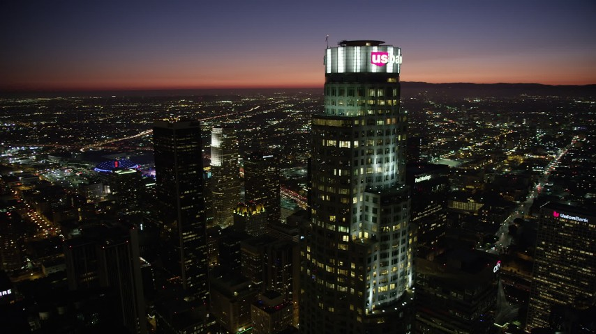 Flyby US Bank Tower and tops of Downtown Los Angeles, California skyscrapers at night Aerial Stock Footage | AX69_123