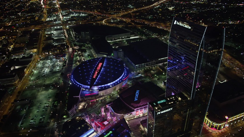 5K stock footage aerial video approach and tilt to Staples Center and Nokia Theater in Downtown Los Angeles, California at night Aerial Stock Footage | AX69_126