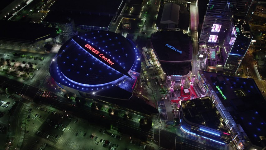 5K stock footage aerial video reverse view of Staples Center, Nokia Center, and Ritz-Carlton in Downtown Los Angeles at night, California Aerial Stock Footage | AX69_127