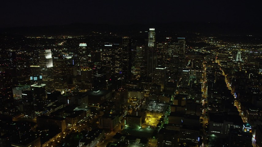 Skyscrapers in Downtown Los Angeles, California at nighttime Aerial Stock Footage | AX69_128