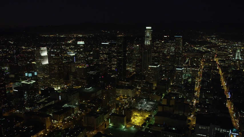 5K stock footage aerial video of skyscrapers in Downtown Los Angeles, California at nighttime Aerial Stock Footage | AX69_128