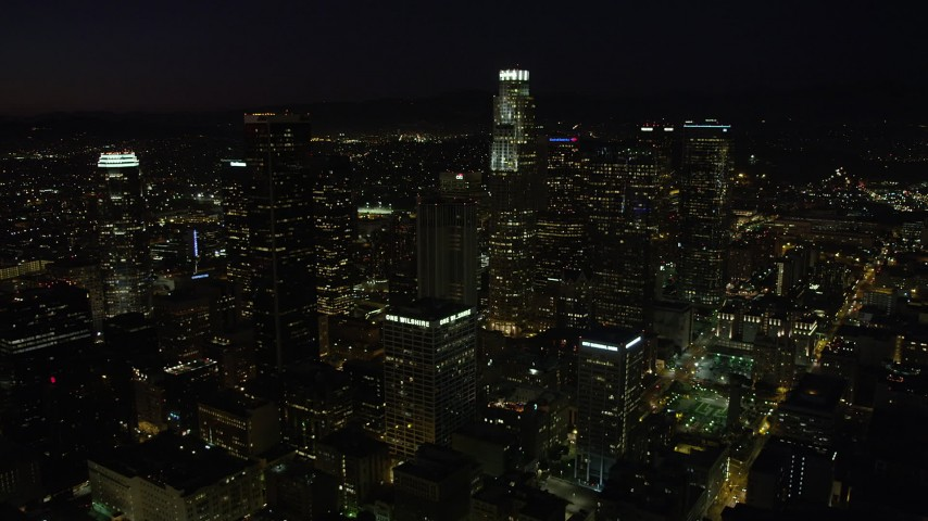 5K stock footage aerial video of a view of US Bank Tower and skyscrapers in Downtown Los Angeles, California at night Aerial Stock Footage | AX69_129