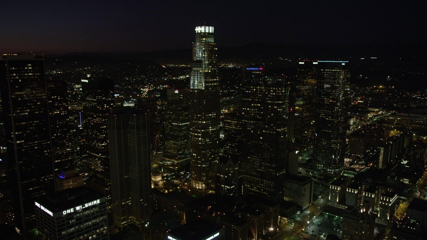 US Bank Tower and skyscrapers in Downtown Los Angeles, California at night Aerial Stock Footage | AX69_130
