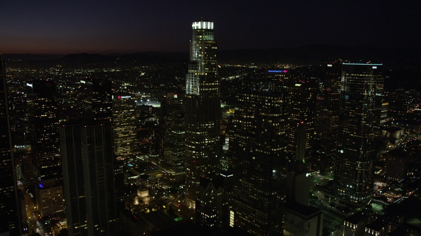 5K stock footage aerial video of US Bank Tower and skyscrapers in Downtown Los Angeles, California at night Aerial Stock Footage | AX69_130