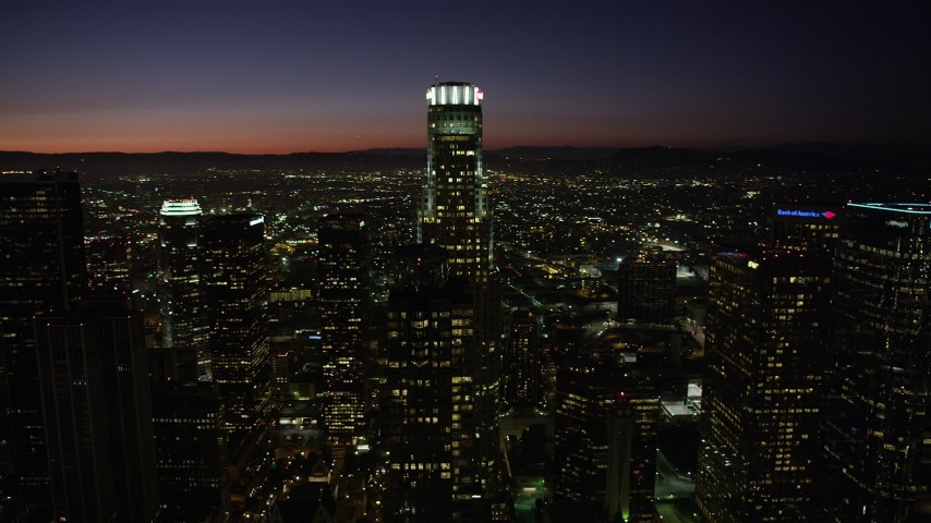 5K stock footage aerial video orbit around US Bank Tower and Downtown Los Angeles high-rises at night, California Aerial Stock Footage | AX69_131