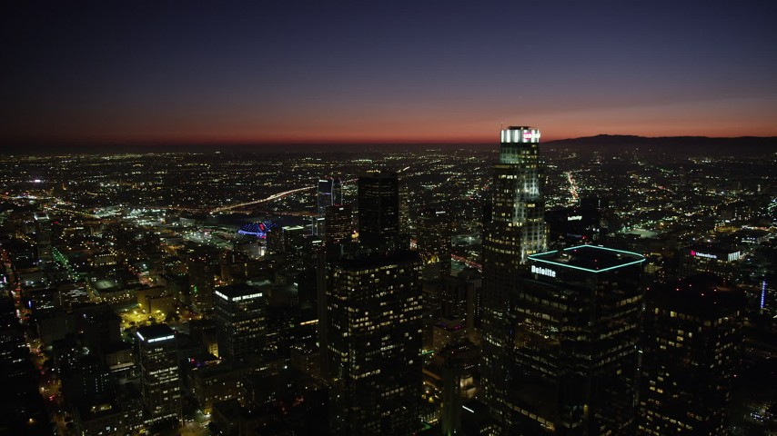 5K stock footage aerial video reverse view of the towers of Downtown Los Angeles at nighttime, California Aerial Stock Footage | AX69_132