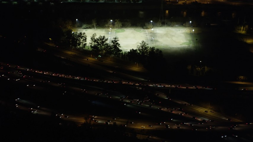 5K stock footage aerial video of rush hour traffic on I-5 and Highway 134 interchange in Glendale at night, California Aerial Stock Footage | AX69_140