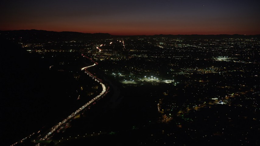5K stock footage aerial video of heavy rush hour traffic on Highway 134 by Burbank at night, California Aerial Stock Footage | AX69_141