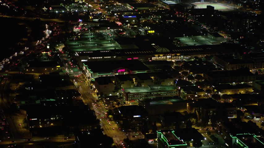 5K stock footage aerial video approach and fly over Burbank Town Center in Burbank, California at night Aerial Stock Footage | AX69_143