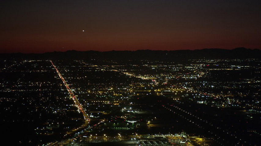 5K stock footage aerial video of runways at Burbank Airport and suburban neighborhoods at night, California Aerial Stock Footage | AX69_145