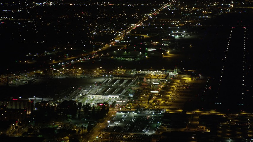 5K stock footage aerial video strip mall by terminals at Bob Hope International Airport at night, Burbank, California Aerial Stock Footage | AX69_146