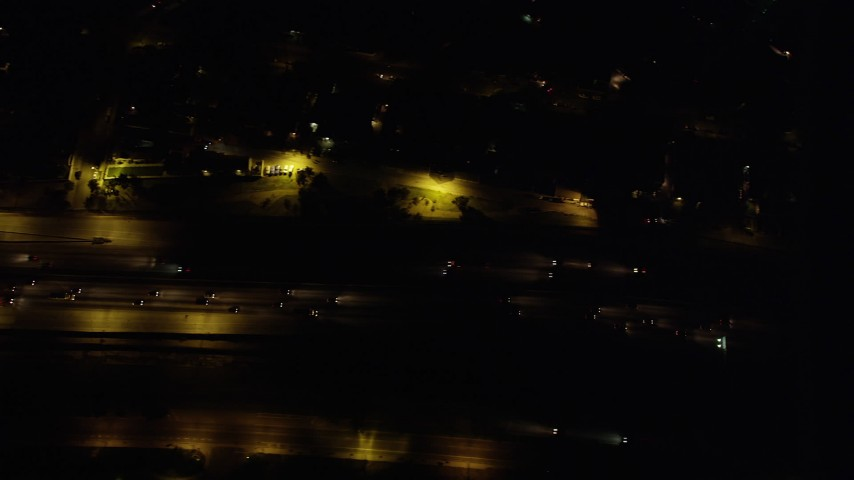 5K stock footage aerial video bird's eye view of light nighttime traffic traveling on Interstate 5 in Burbank, California Aerial Stock Footage | AX69_149