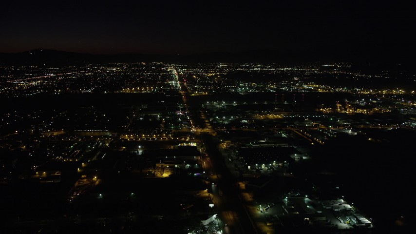5K stock footage aerial video of warehouse buildings on San Fernando Road at night in Pacoima, California Aerial Stock Footage | AX69_151