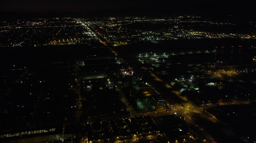 5K stock footage aerial video of Pacoima warehouse buildings on San Fernando Road at nighttime, California Aerial Stock Footage | AX69_152