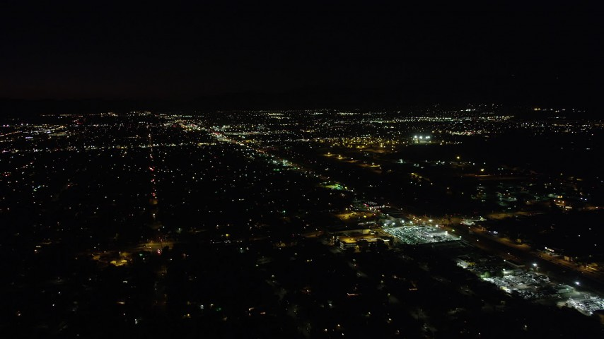 5K stock footage aerial video fly over neighborhoods and pan to Whitman Airport in Pacoima at night, California Aerial Stock Footage | AX69_154