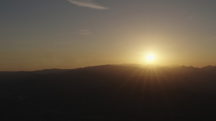 4K stock footage aerial video Sunrise over the mountains Aerial Stock Footage | AX70_001