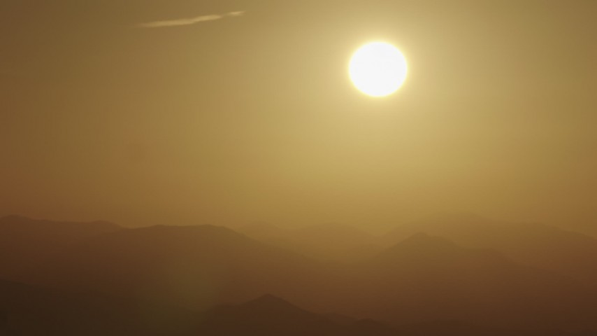 4K stock footage aerial video The sun rising over the mountains Aerial Stock Footage | AX70_003