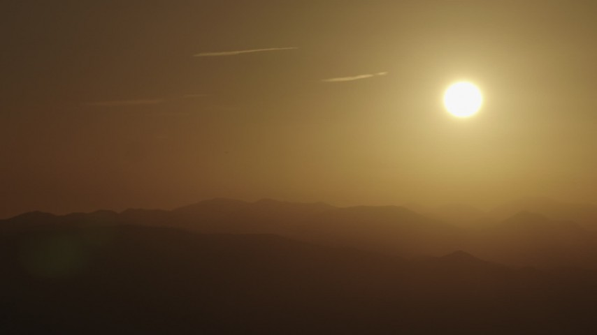 4K stock footage aerial video The rising sun over mountains Aerial Stock Footage | AX70_004