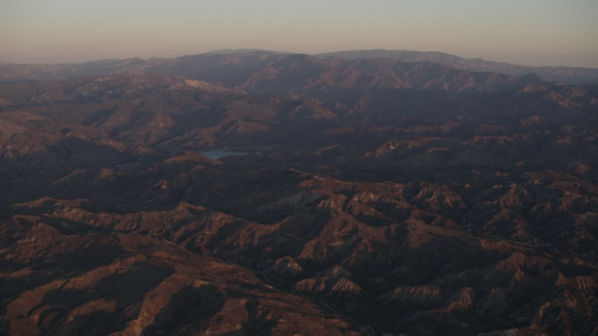 4K Aerial Video Fly over Los Padres National Forest to approach a lake at sunrise, California Aerial Stock Footage | AX70_005